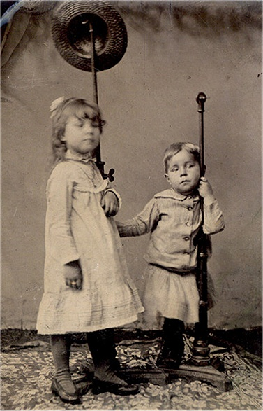 2 children posing with posing stands